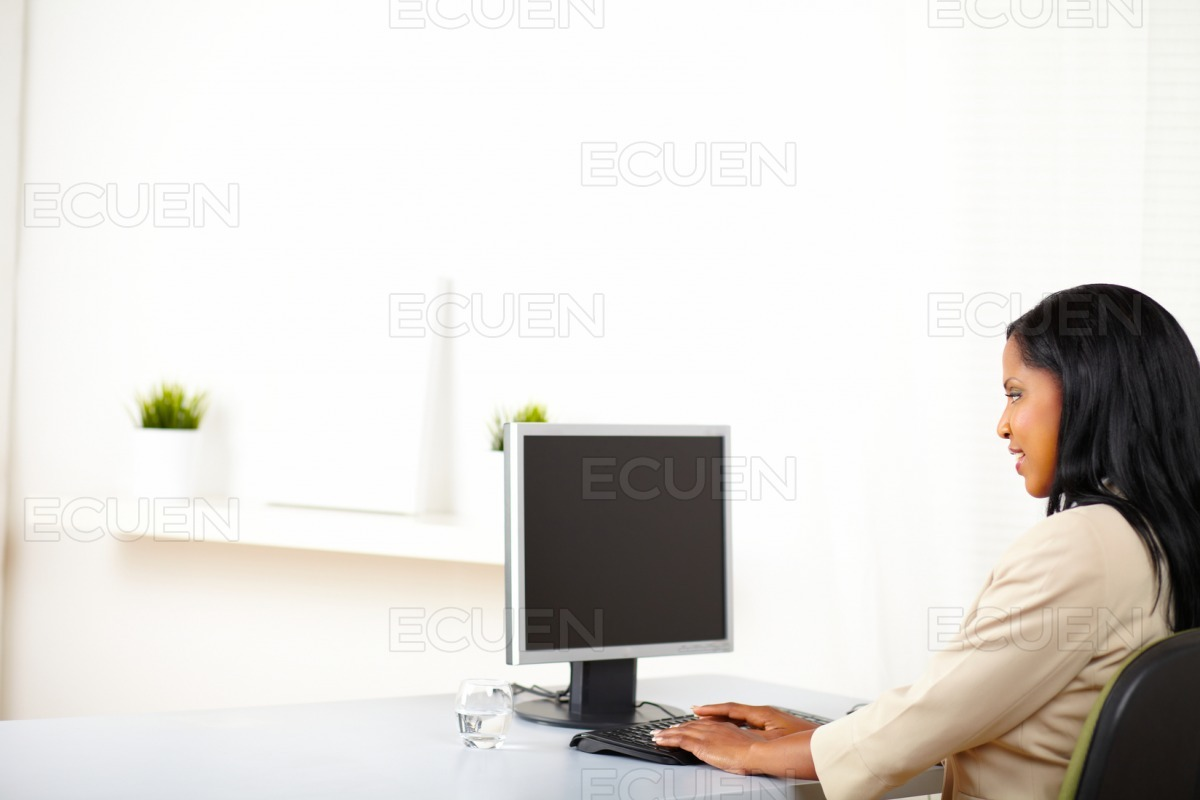 Professional lady working on computer stock photo