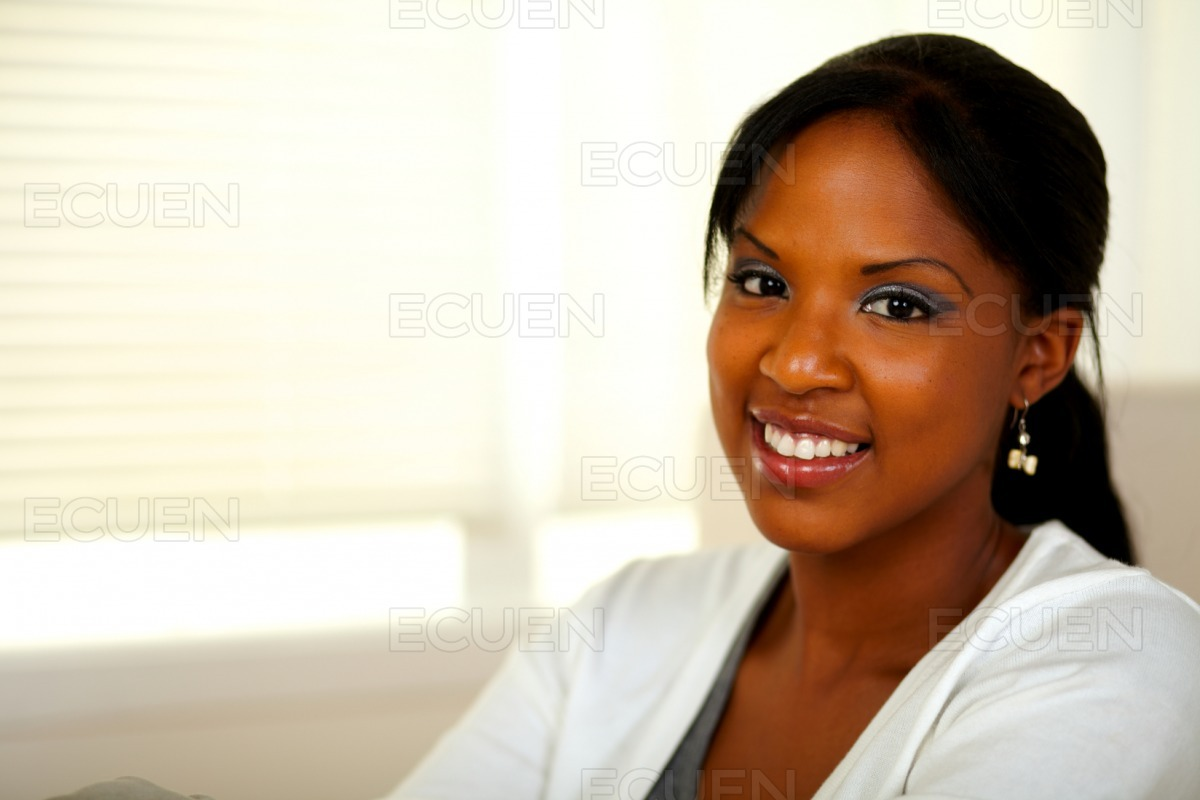 Relaxed afro-american young female smiling at you stock photo