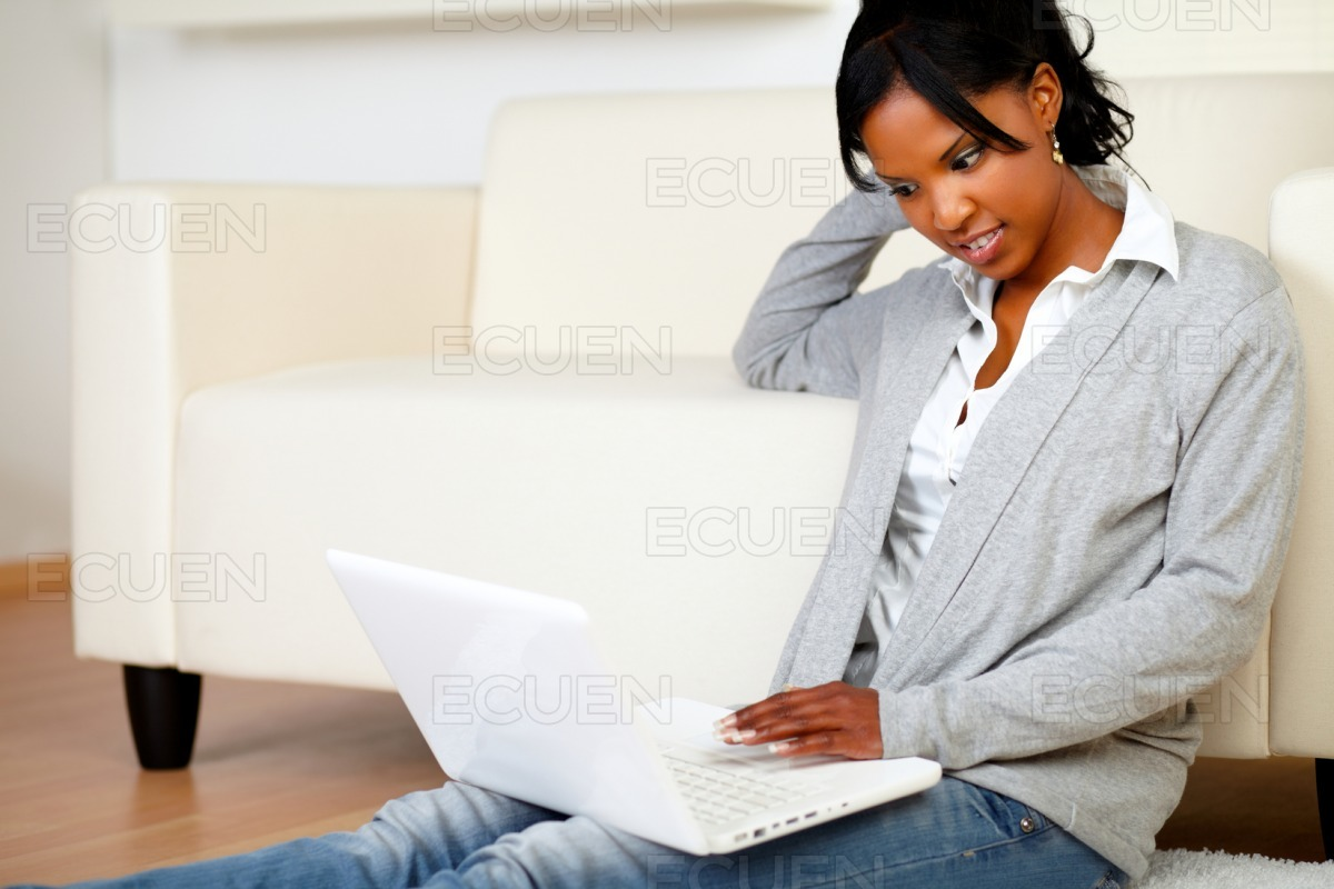 Relaxed black woman browsing the Internet stock photo
