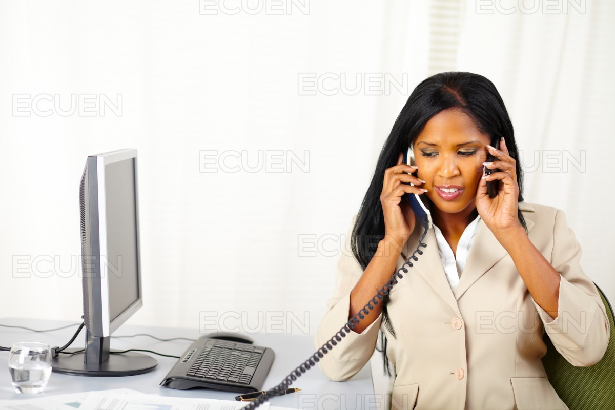 Secretary talking with two persons stock photo