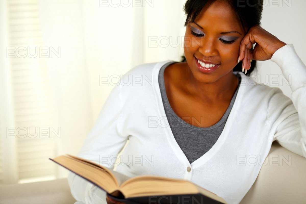 Smiling black woman reading a book stock photo