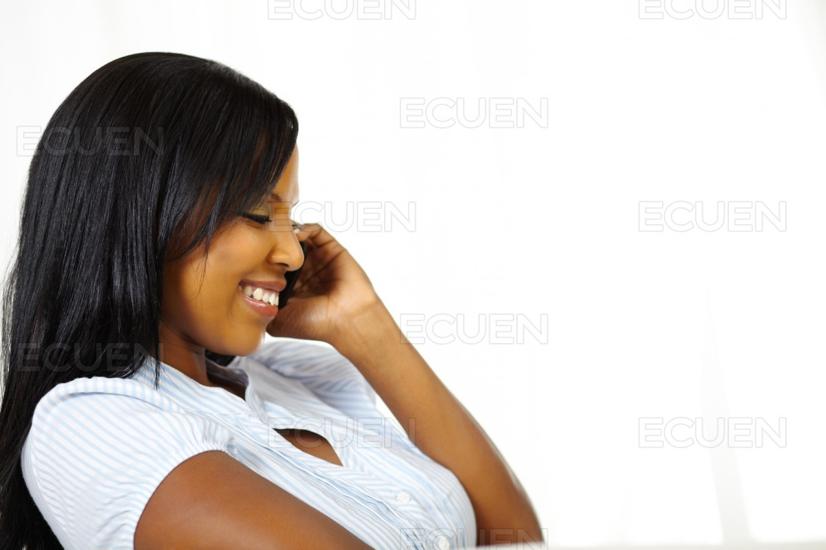 Smiling pretty young woman on cell phone stock photo