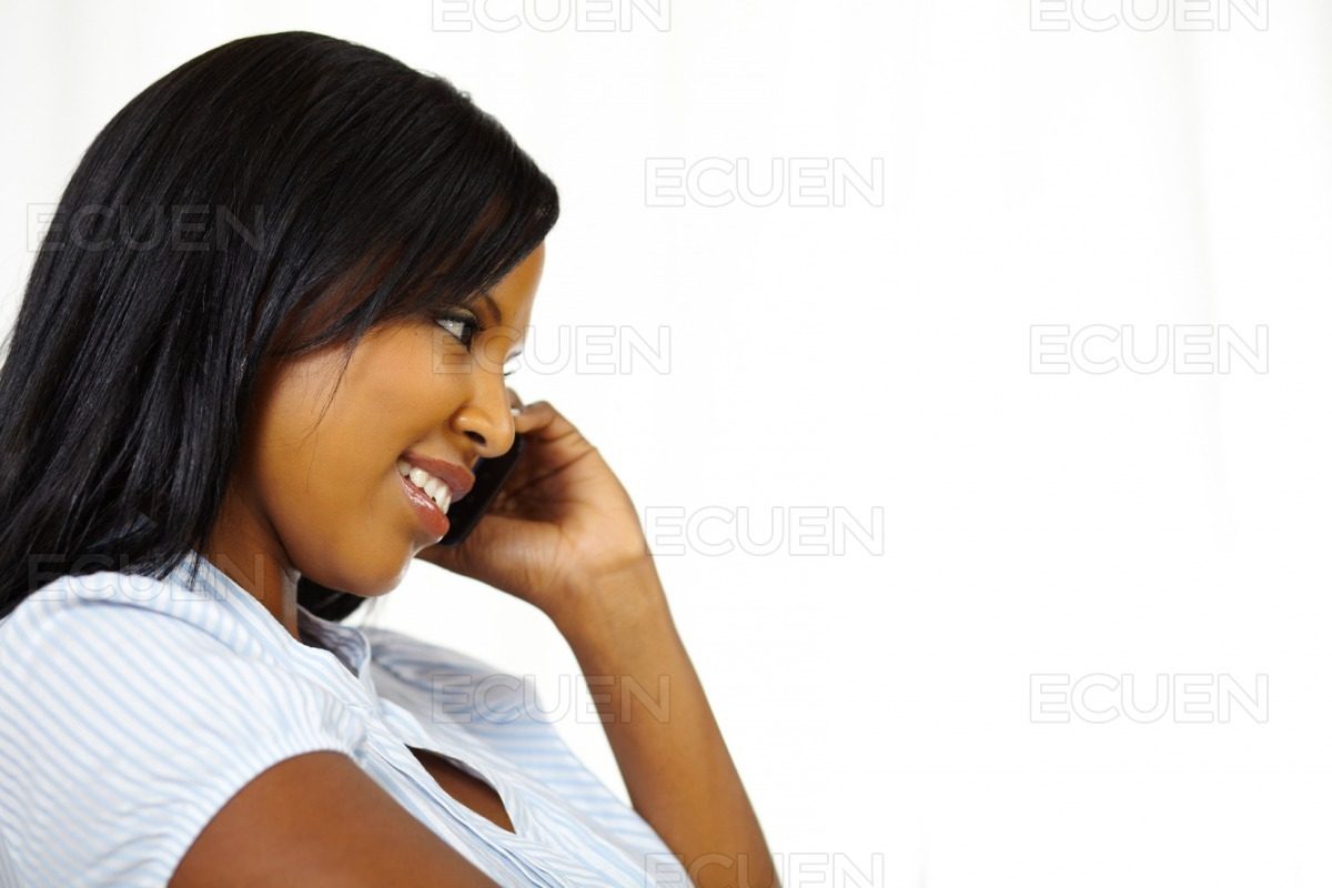 Smiling young woman on cellphone stock photo