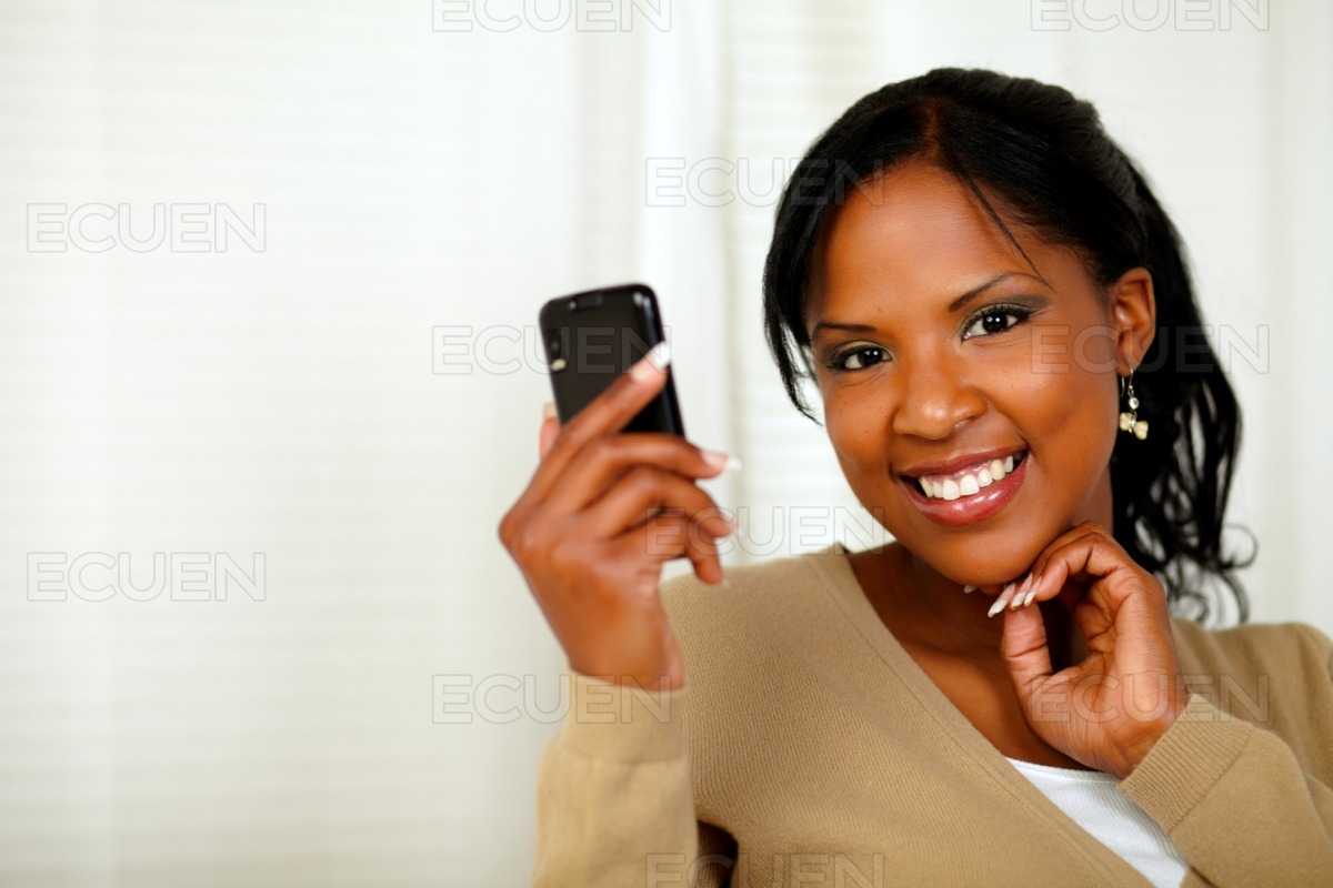 Sophisticated lady reading a message on cellphone stock photo