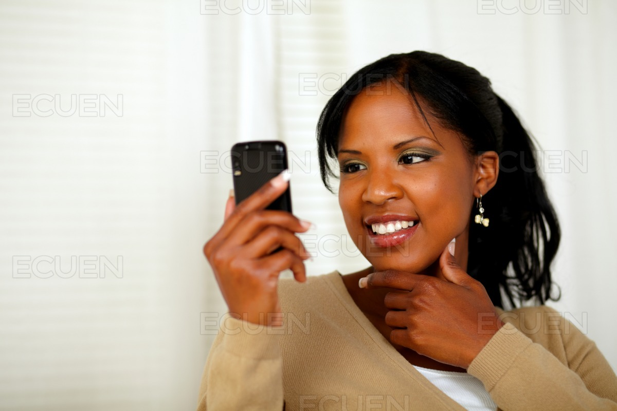 Sophisticated woman reading a message on cellphone stock photo
