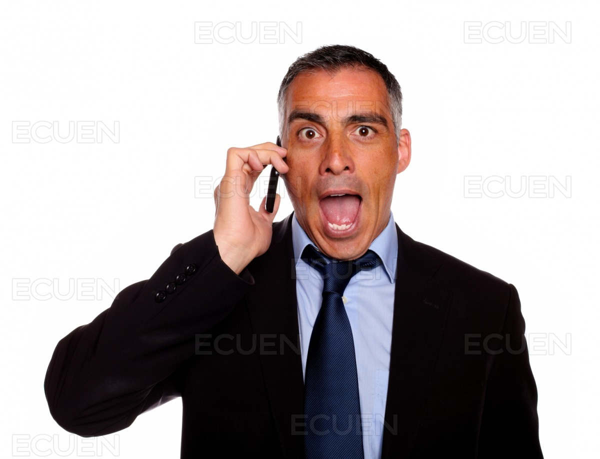 Surprised business man on cellphone stock photo