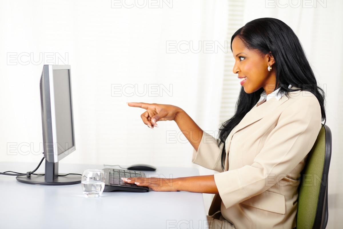 Surprised young lady at work stock photo