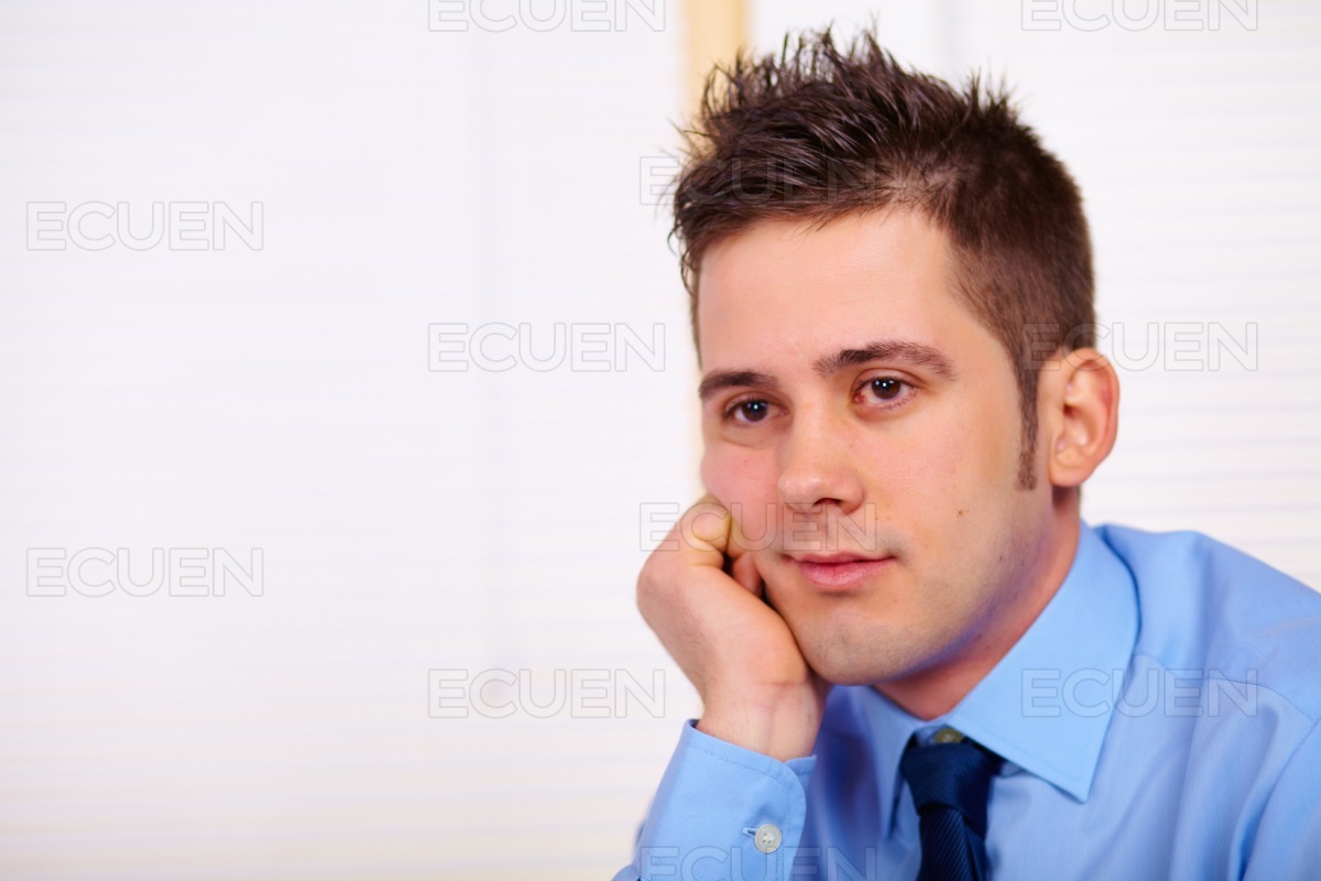 Tired young business man stock photo