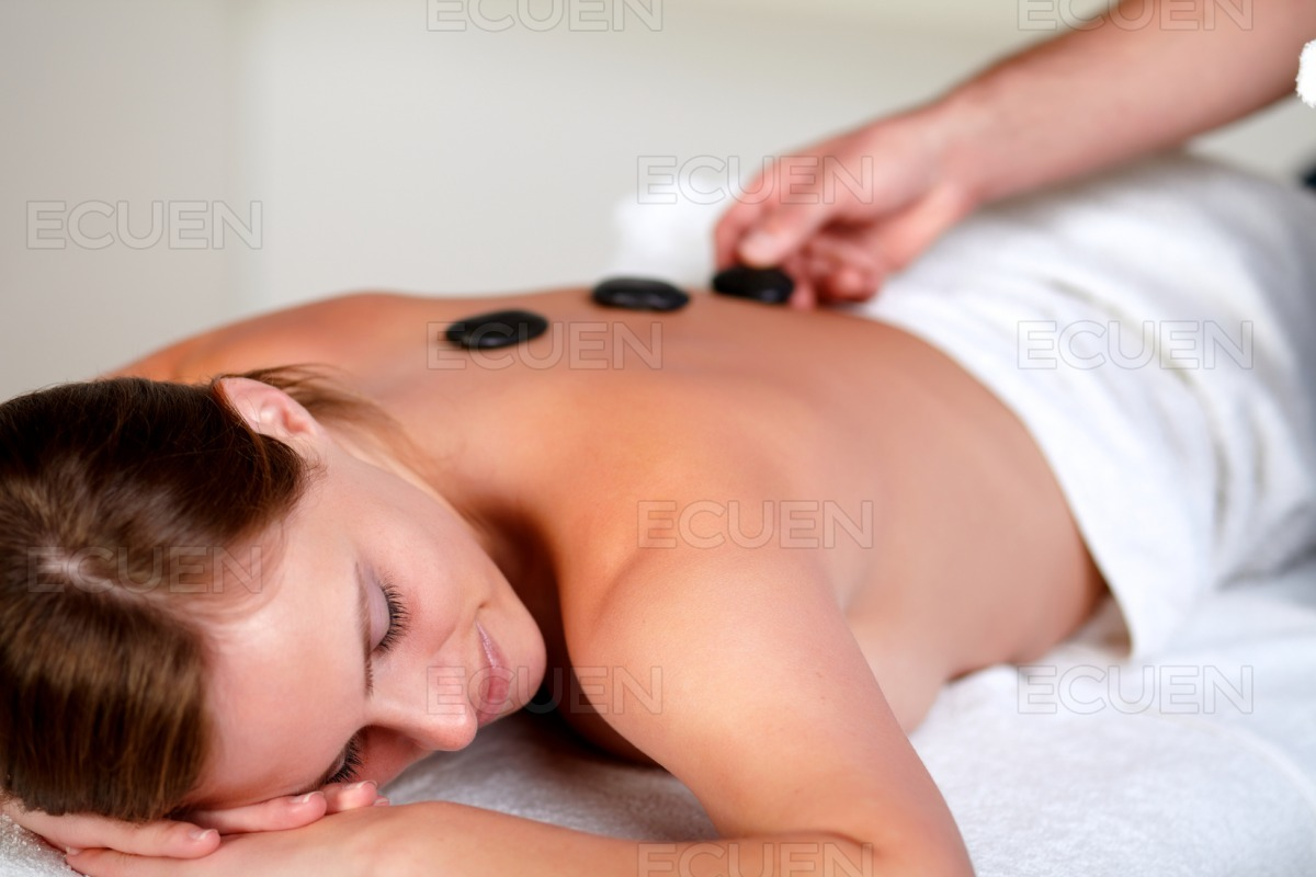 Tired young woman relaxing at a spa stock photo