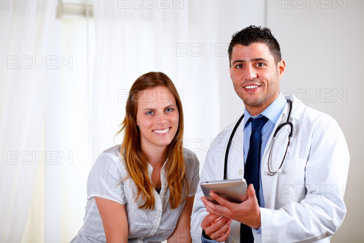 Young blonde woman with her medical doctor stock photo