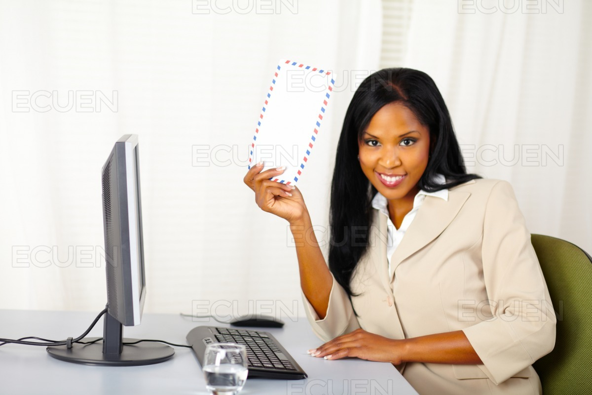 Young business lady showing a letter stock photo