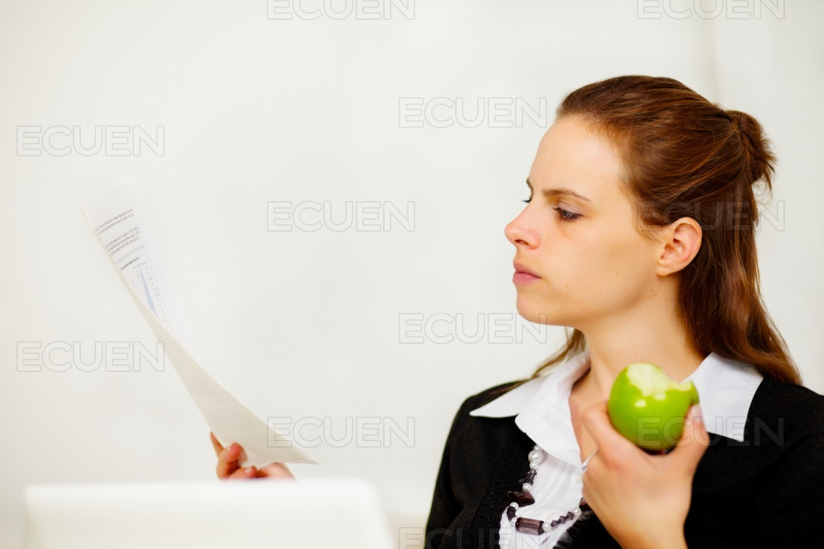Young business woman looking to a document stock photo