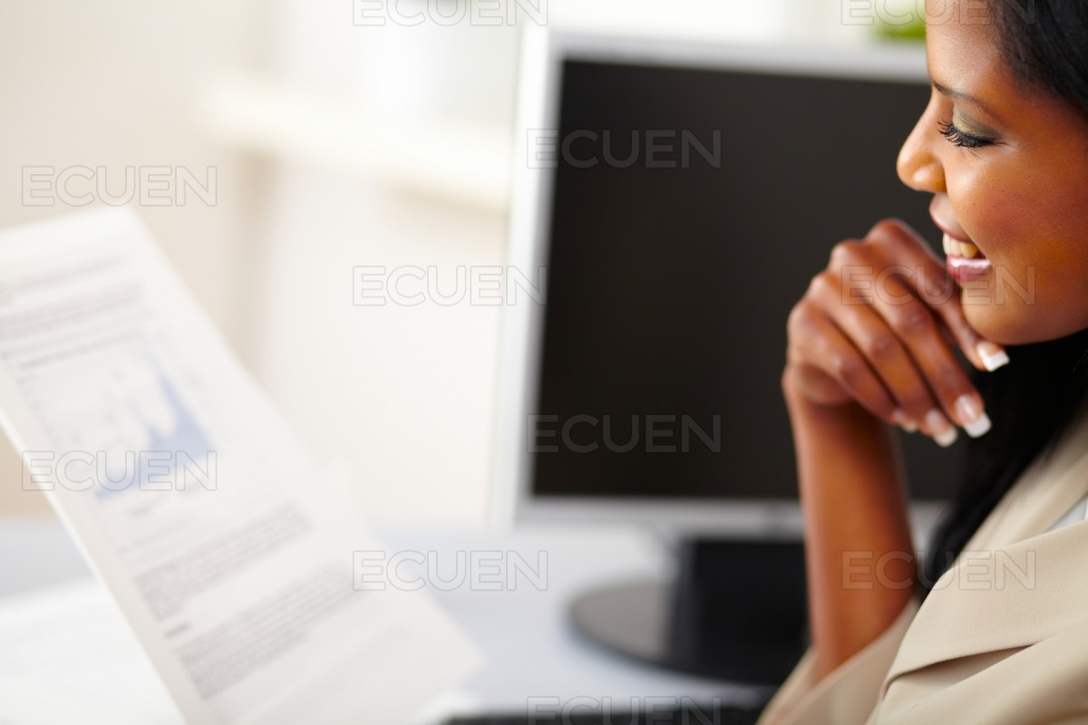 Young business woman reading documents stock photo