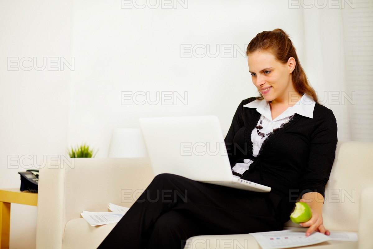 Young business woman working on sofa stock photo