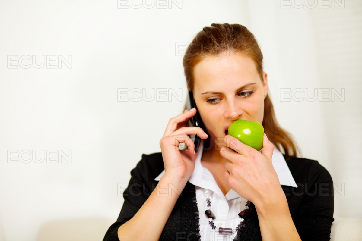 Young businesswoman on mobile phone stock photo
