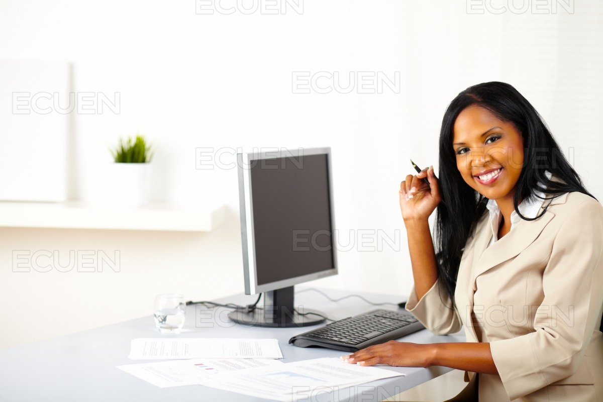 Young businesswoman on work desk stock photo