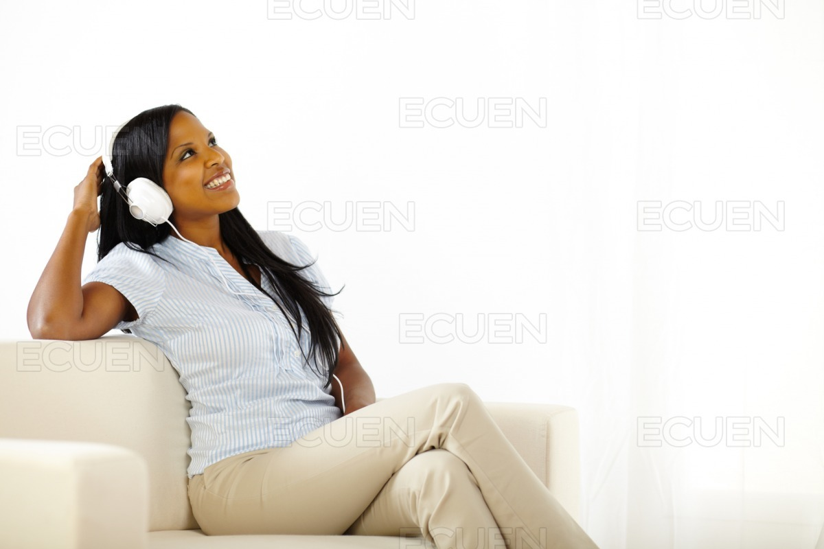 Young female listening to music stock photo