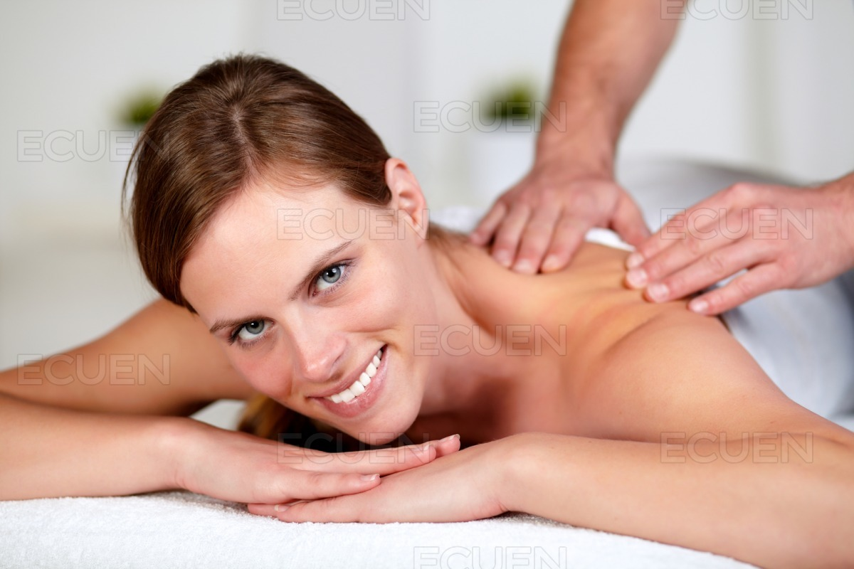 Young female receiving a relaxed massage at a spa stock photo