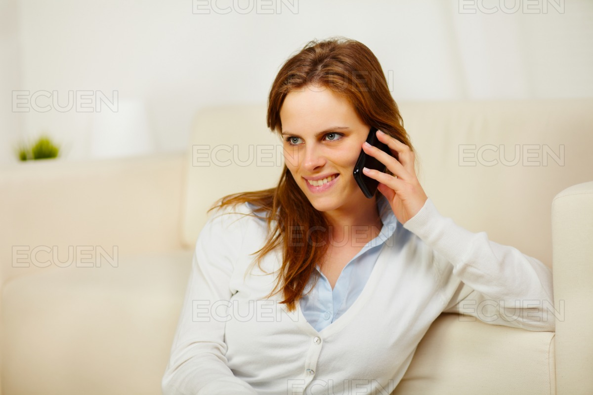 Young lady enjoying conversation on cell phone stock photo