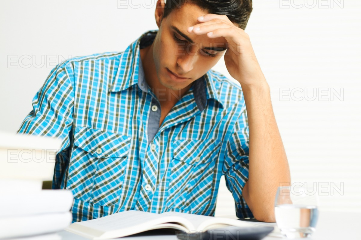 Young man concentrating stock photo