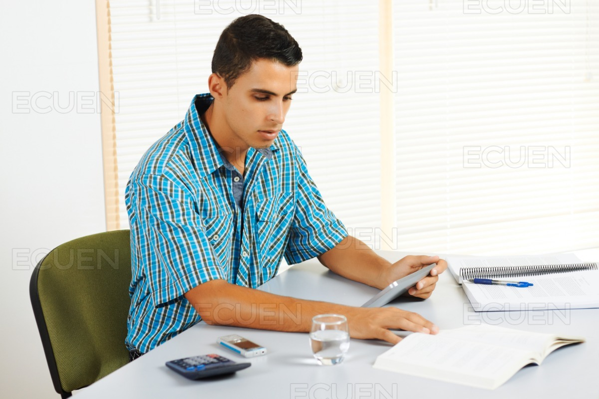 Young man studying with a tablet PC stock photo