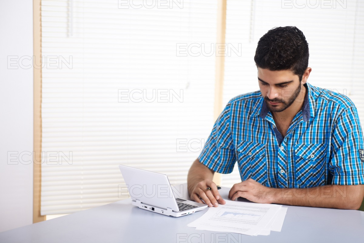 Young man using a computer stock photo