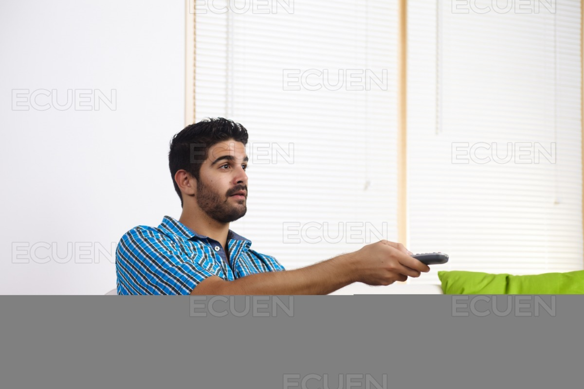 Young man watching television stock photo
