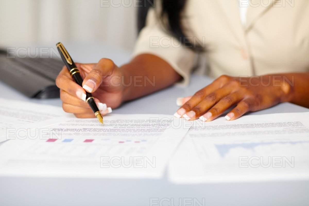 Young professional working on documents stock photo