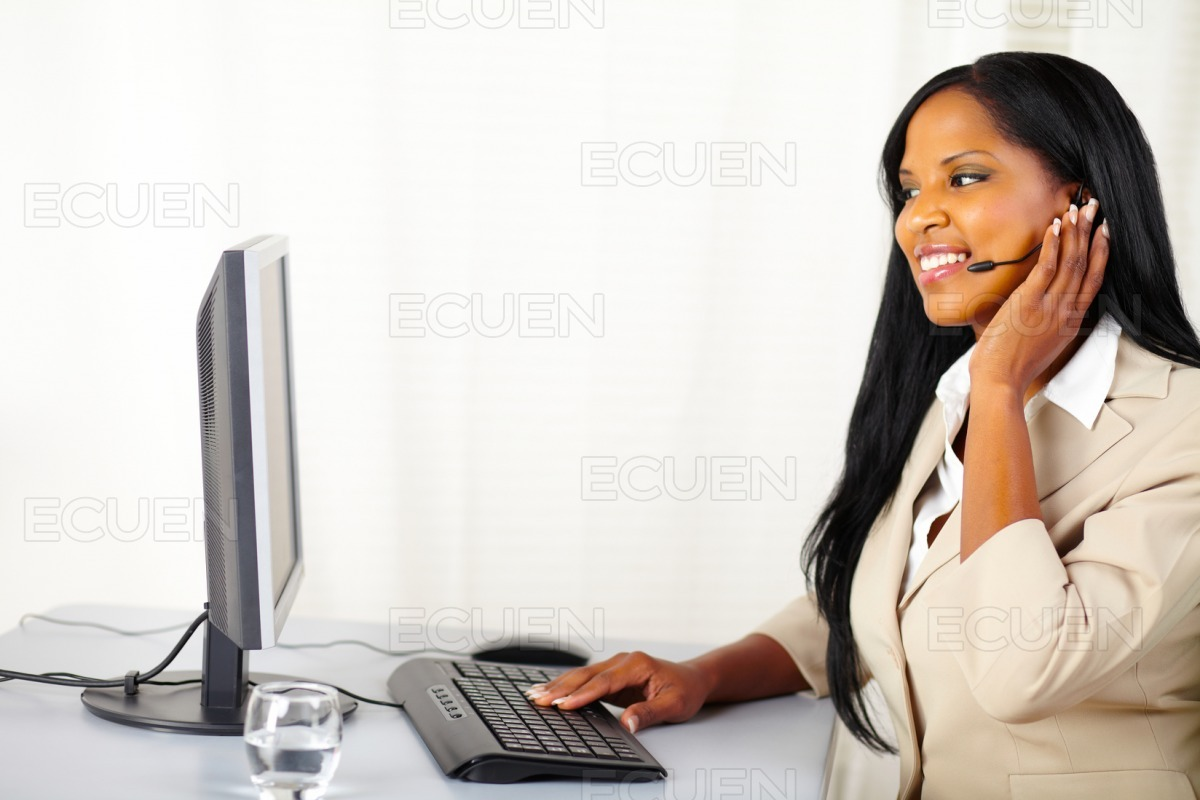 Young secretary working on a callcenter stock photo