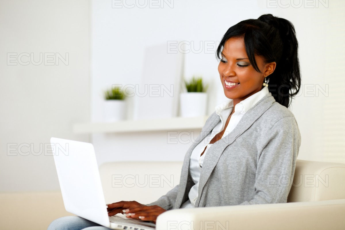 Young woman browsing the Internet on laptop stock photo