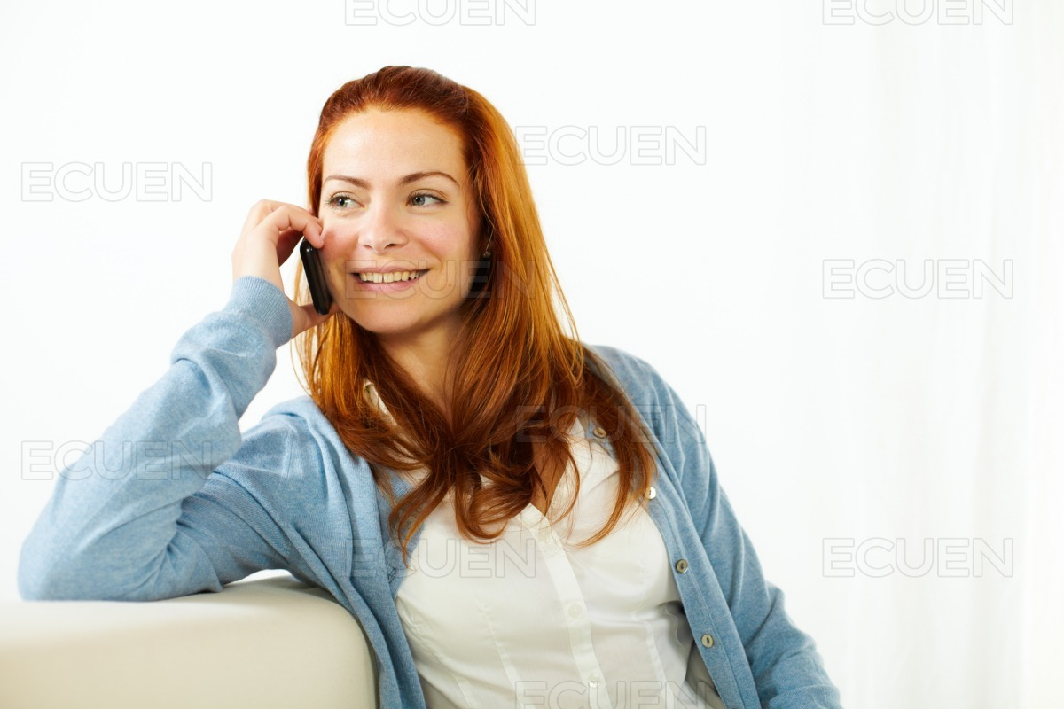Young woman conversing on mobile phone stock photo