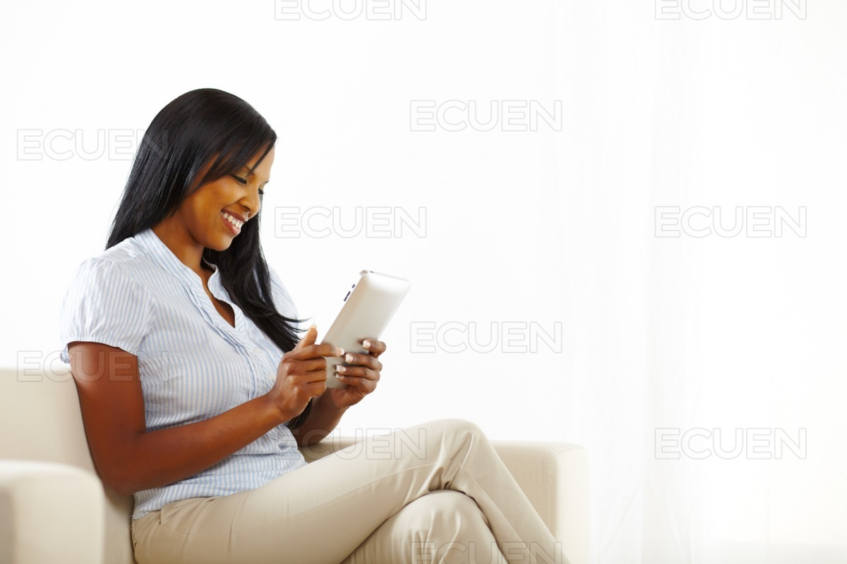 Young woman having fun with a tablet PC stock photo