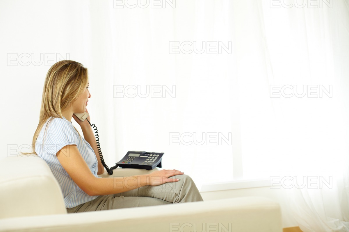 Young woman on phone. stock photo