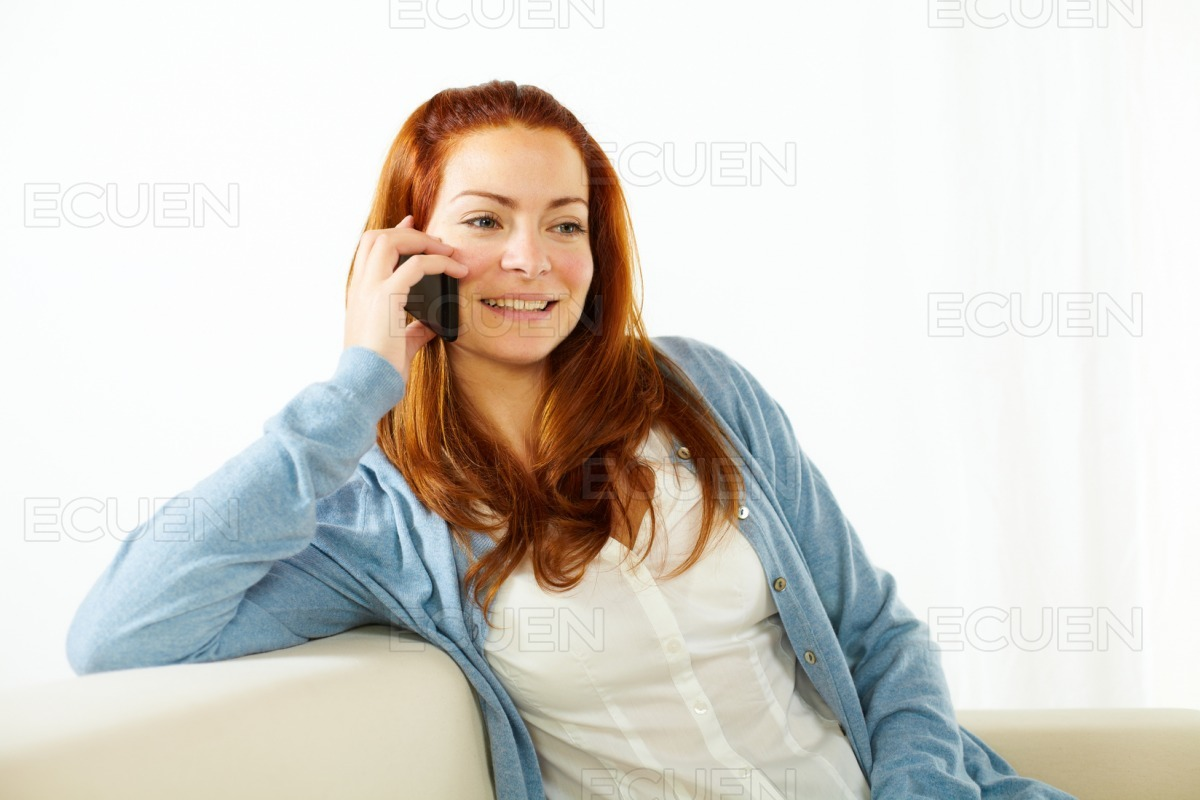 Young woman talking at mobile phone stock photo