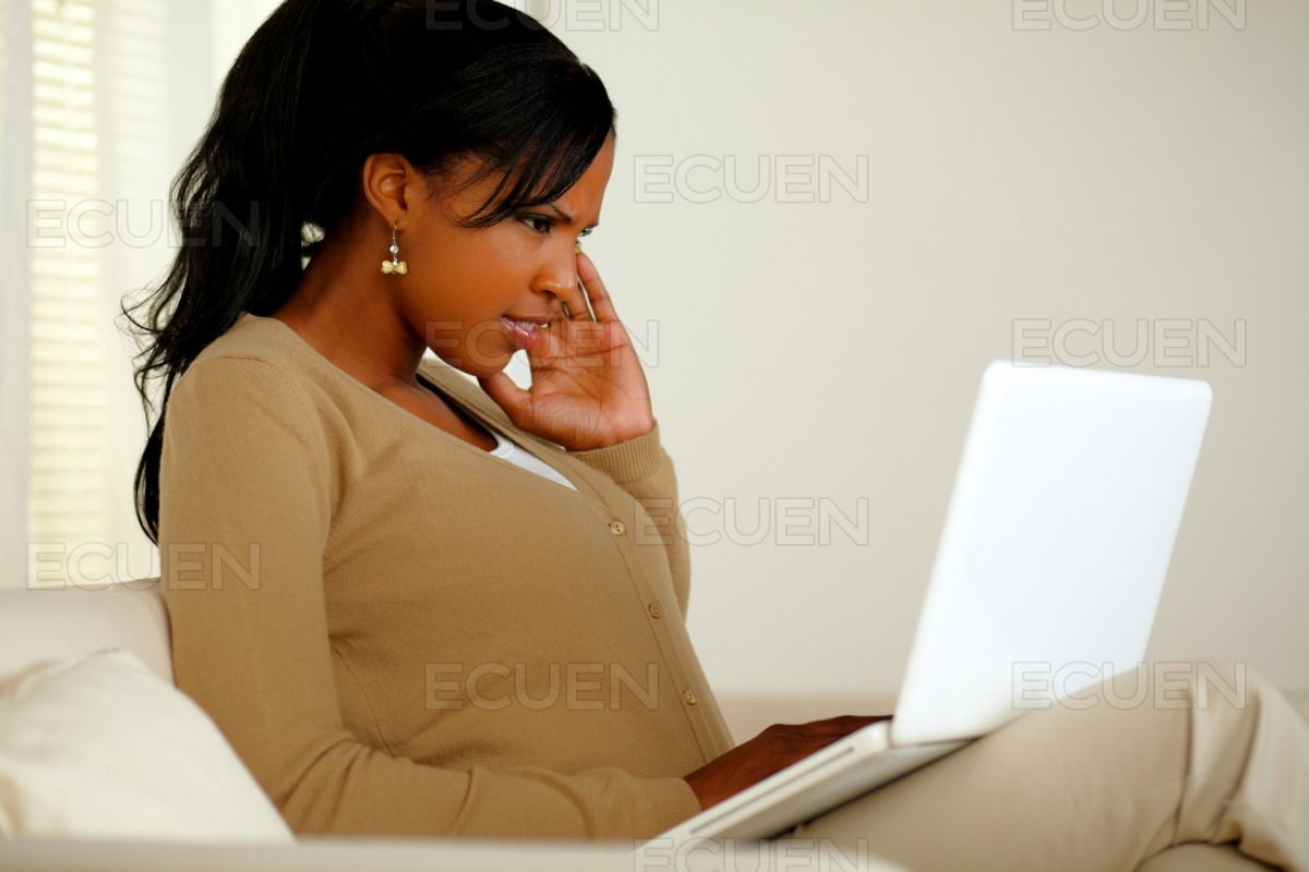 Young woman with headache working on laptop stock photo