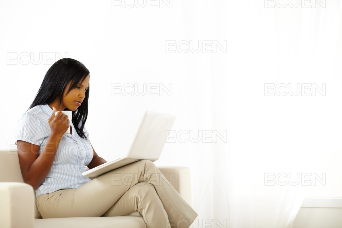 Young woman working on laptop stock photo