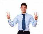 Adult man standing making victory sign
