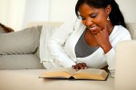 Afro-american woman reading a book