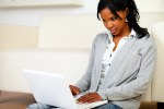 Afro-american young female using her laptop