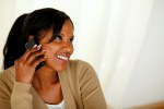 Afro-american young woman conversing on cellphone