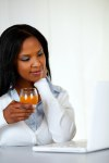 Afro-american young woman drinking orange juice