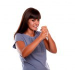 Angry latin young woman with clenched fists