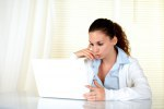 Attractive female working on laptop