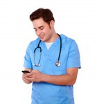 Attractive nurse man texting on cellphone