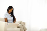 Black young woman browsing on laptop