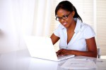 Black young woman using her laptop