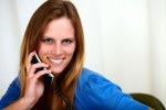 Caucasian blonde woman on phone smiling