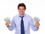 Charming man smiling and showing you cash dollars