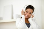 Charming woman with headphone listening music