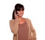 Charming young female conversing on cellphone